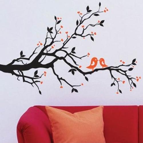 Adesivo con una coppia di uccellini sul ramo dell'albero